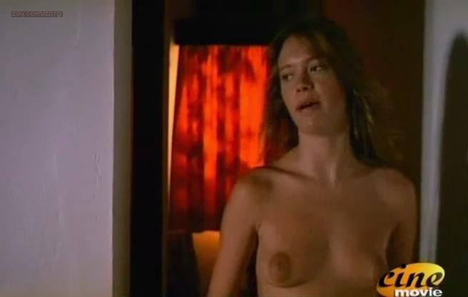 Anna Falchi nude topless with pre boobs work - Nel continente nero (IT-1993)